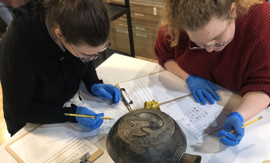 Students working with museum permanent collection as part of Professor Scott Smith's ANT253, Andean Archaeology.