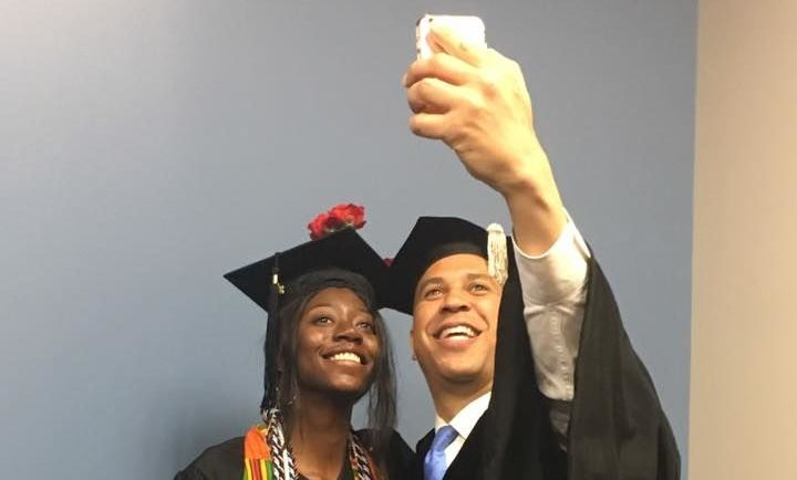 Commencement Speaker Senator Cory Booker takes a selfie with AMS Grad Charisma Lambert '18.