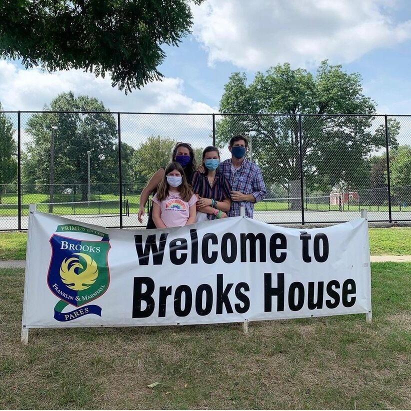 Family pictured with Brooks welcome banner