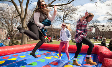 Students enjoy the various activities on Hartman Green during Spring Arts Festival.