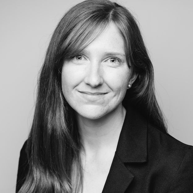 A black and white portrait photo of Heather Cann.