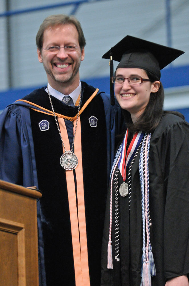 President Daniel R. Porterfield, Ph.D., congratulates Williamson Medalist Chelsea Schein '11.