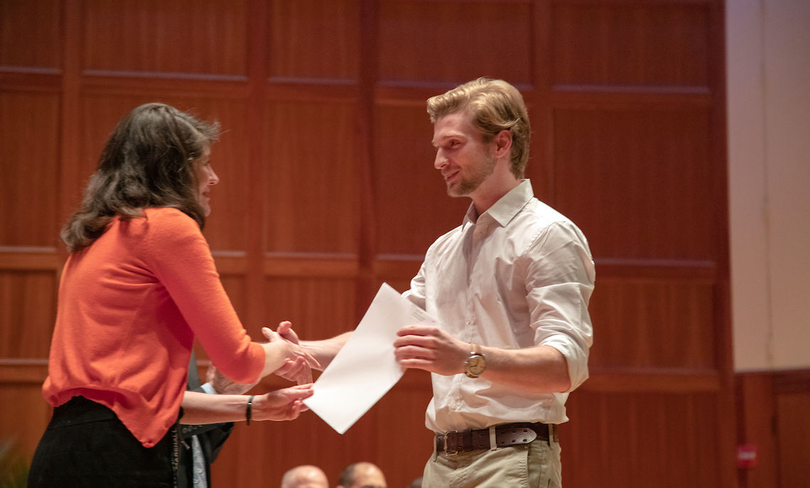 Among the award winners was senior Lucas Groff, who Dean Shaw presents with the Muhlenberg Goodwill Award.