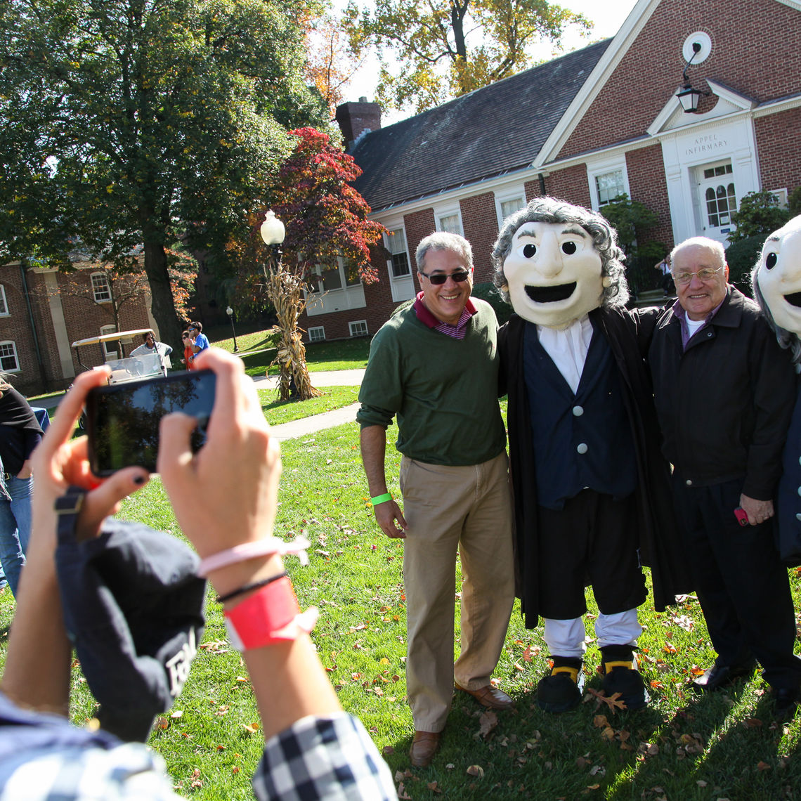 Alumni are eager to get their photos taken with College mascots Ben and John, who spent the weekend wandering campus, greeting people and giving out the occasional hug.