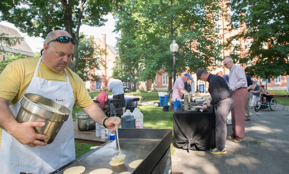 Crime Prevention Officer Keely Johnston serves breakfast at Flapjack Fest on Saturday morning.