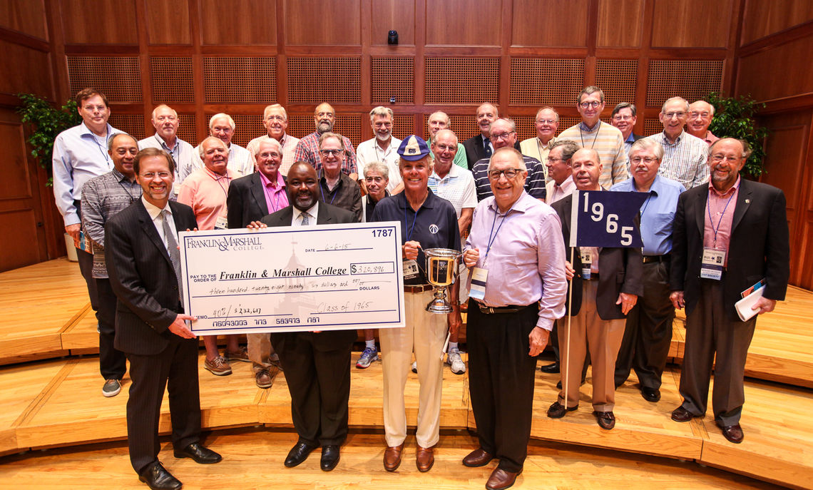 Porterfield and Alumni Association President Ricardo Rivers with the Class of '65 and their generous gift. The class, with a 40 percent participation rate, was this year's recipient of the President's Cup, presented to the Reunion class with the highest percentage of members giving to F&M.