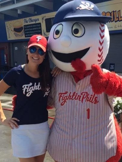 """Alexy Posner '13 with """"Screwball,"""" the Reading Fightin Phils mascot"""