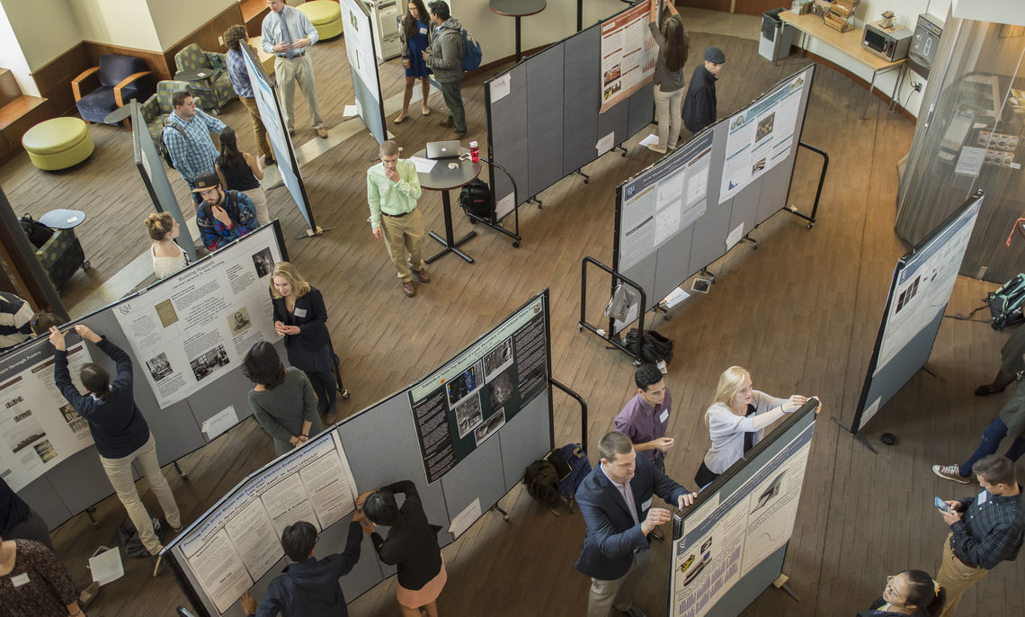 Students set up their posters for Friday's Autumn Research Fair.
