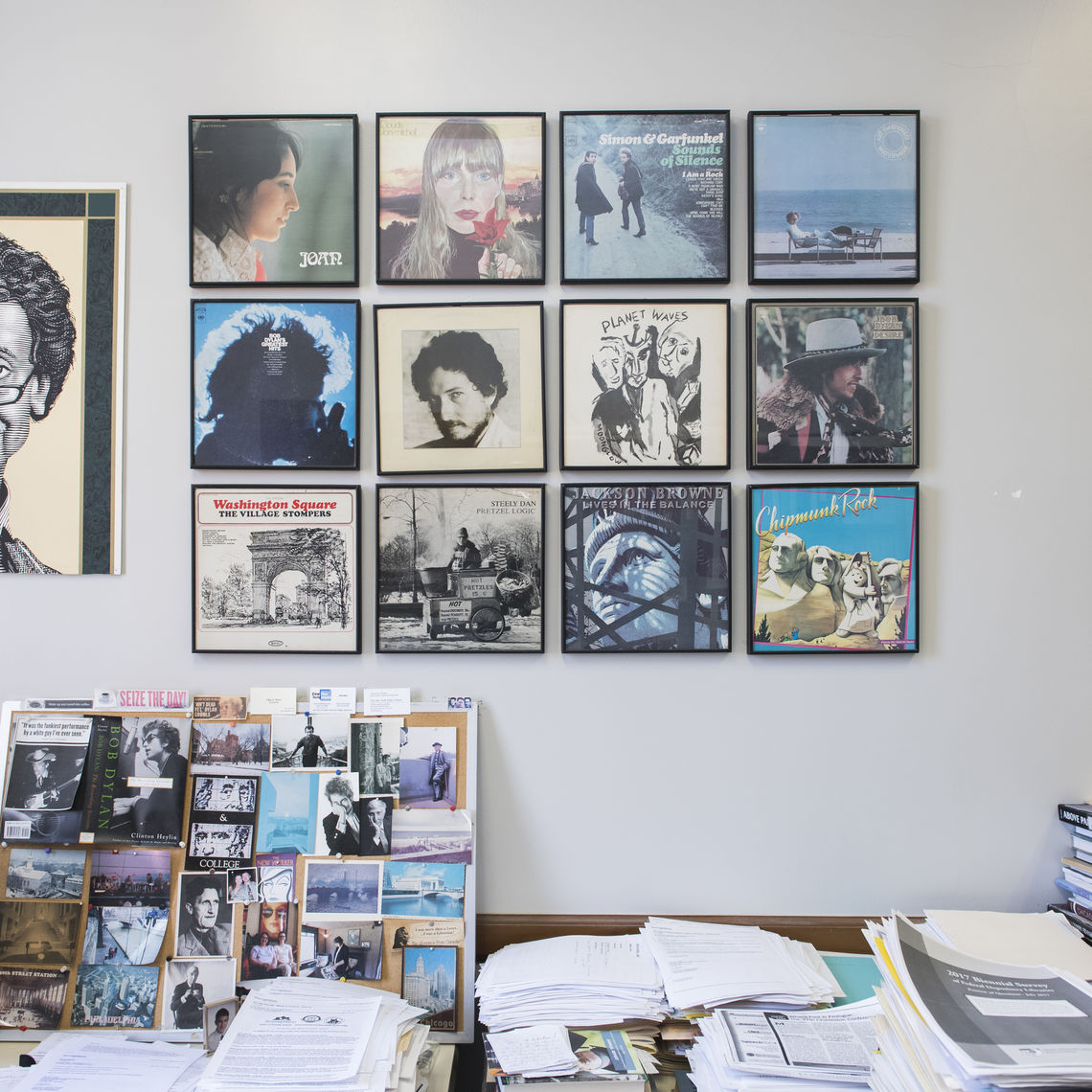 Album covers adorn the library office wall of Tom Karel, F&M's resident scholar and expert on Bob Dylan.