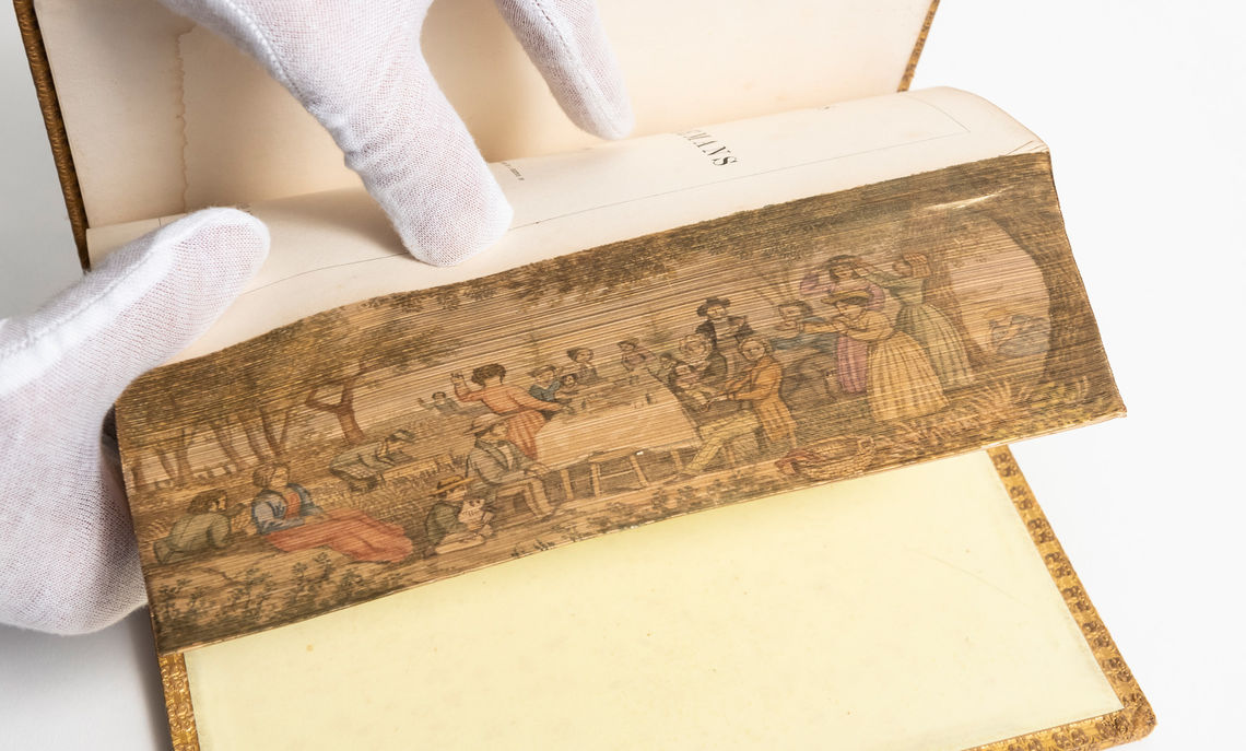 """""""Poems of Felicia Hemans,"""" published in 1852, is an example of a fore-edge painting, one of several in the College's collection of rare books."""
