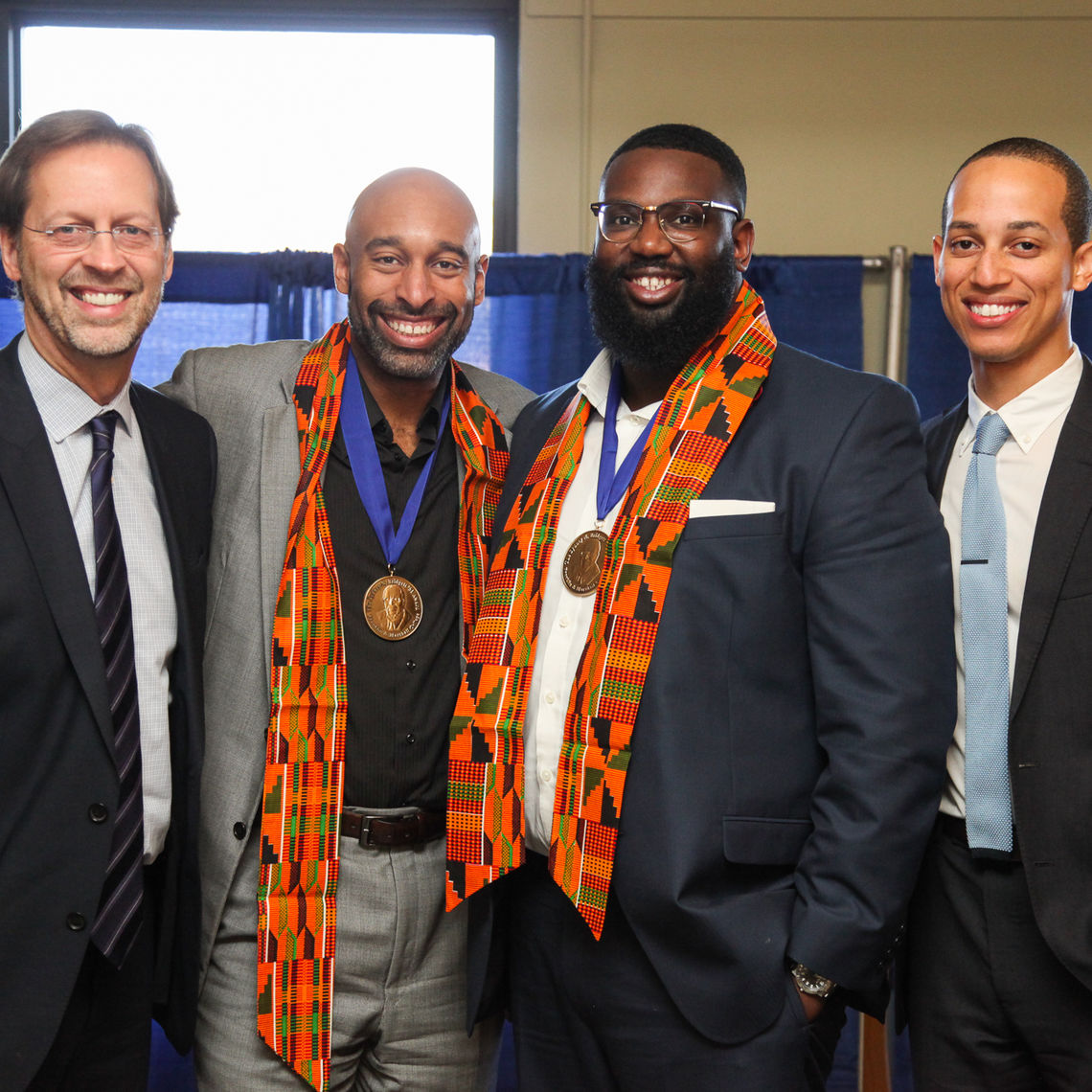 At the African American Alumni Council breakfast Saturday, F&M President Daniel R. Porterfield joins Donnell Butler '95 and Joaquim Hamilton '06, recipients of the Sydney N. Bridgett '51 Award for outstanding achievement in a professional endeavor. Also pictured is Shadoe Tarver '10, this year's Gold Award recipient for significant service to F&M. Unable to attend the event were Wanda Austin '75 and Horace Madison '88.