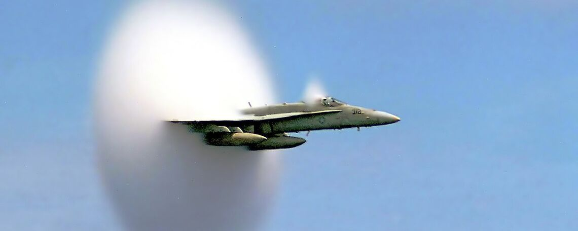 An F/A-18 Hornet assigned to Strike Fighter Squadron One Five One breaks the sound barrier in the skies over the Pacific Ocean in 1999.