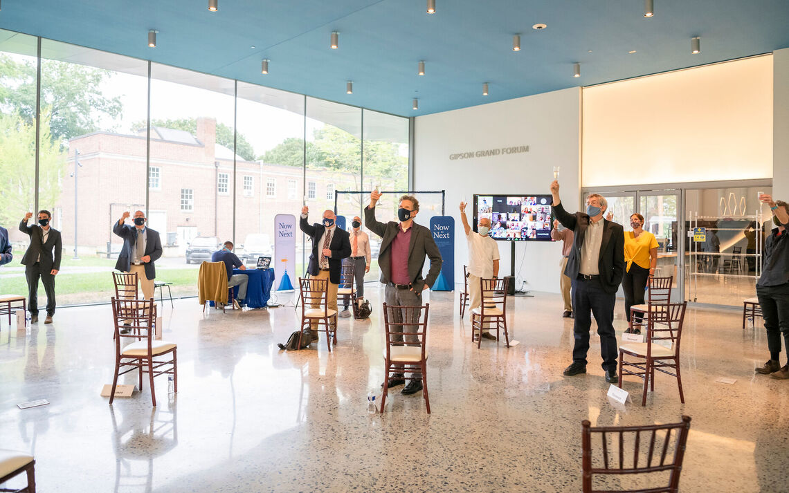 Guests raise their glasses in honor of the opening of the Susan and Benjamin Winter Visual Arts Center at Franklin & Marshall College.