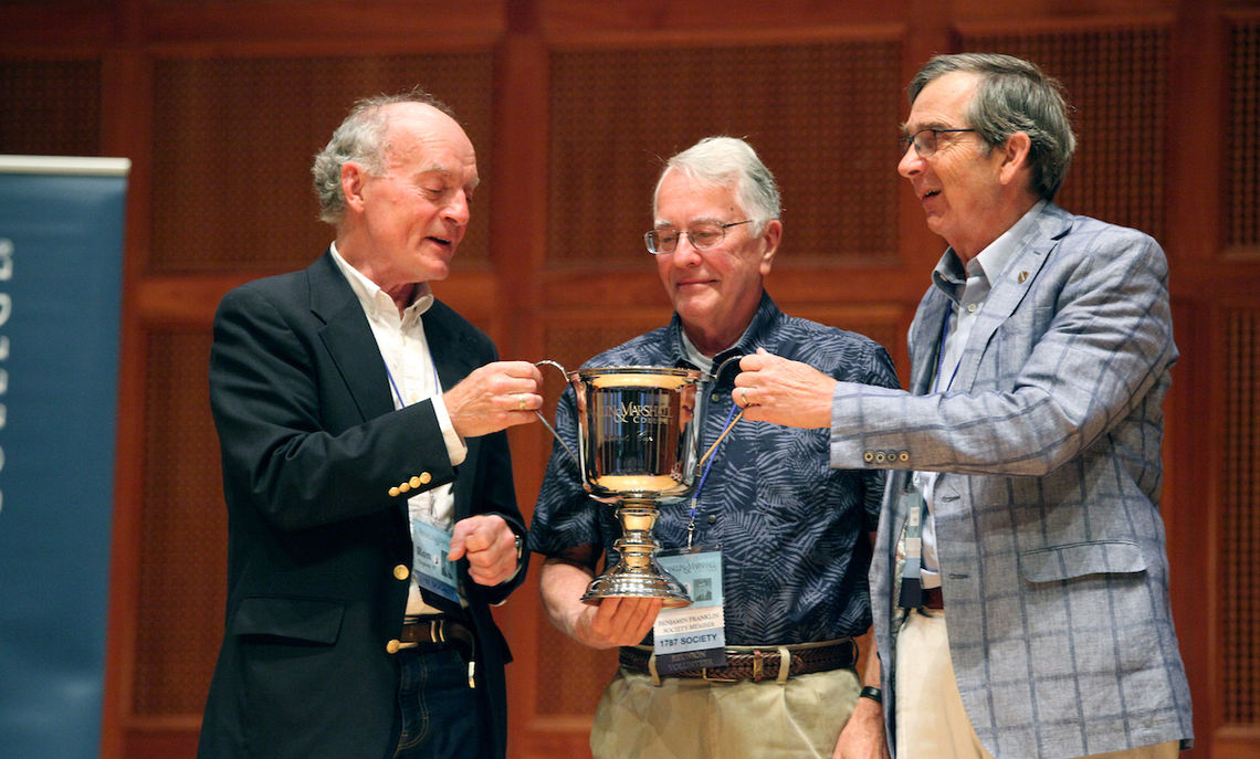 Ron Deprez, Ted Podkul and Bob Falk, co-chairs of the Class of 1967, receive the President's Cup on behalf of the 50th reunion class, which raised more than $2.3 million for the College.