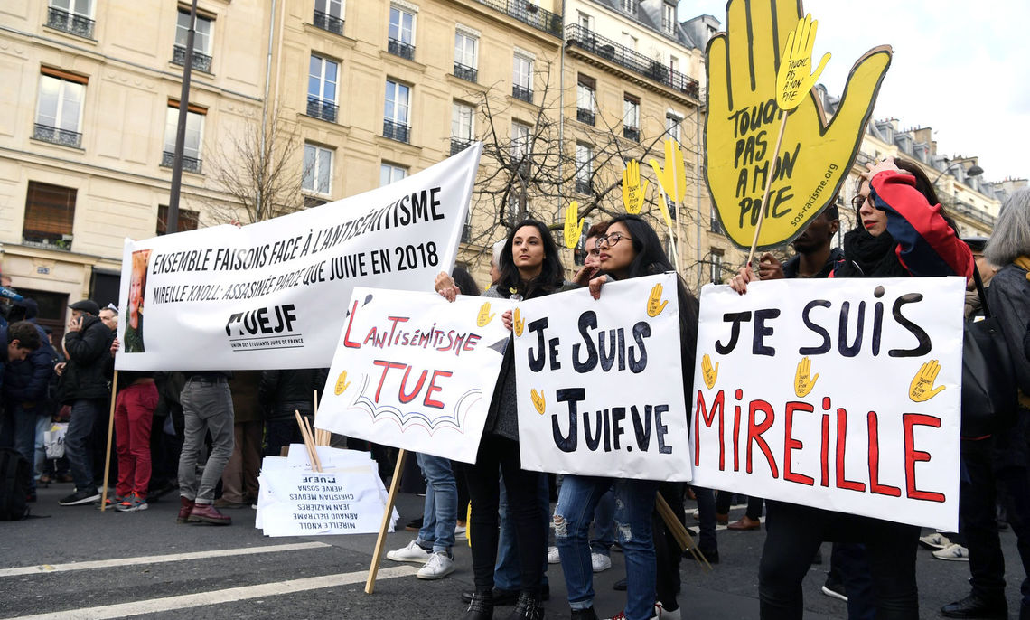 Christy Illescas '19, center, interned with the French nonprofit, SOS Racisme, during her semester abroad in Paris. She marched alongside her colleagues in protest of anti-Semitism.