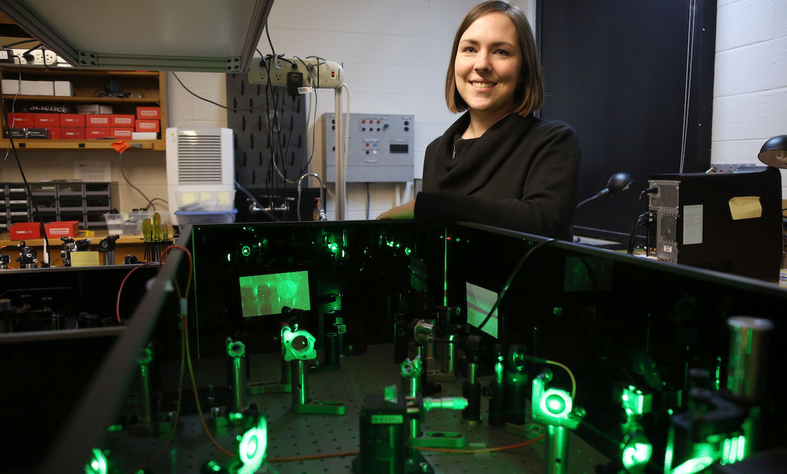 """Lytle's research involves the study of a process called """"second harmonic generation,"""" converting light from one color to another."""