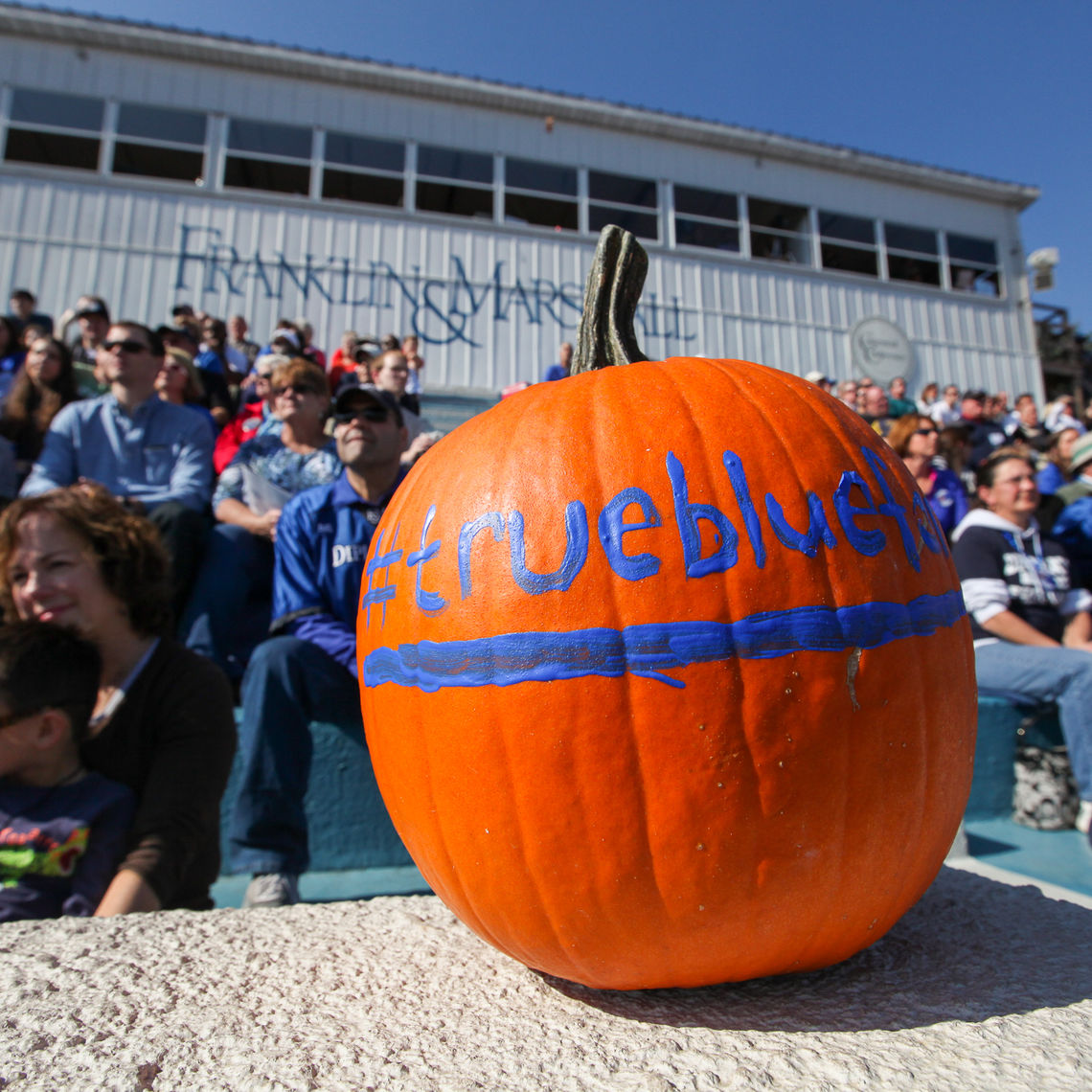 Pumpkins such as this one, sporting the hash tag #truebluefandm, abound on a brisk Saturday in autumn, perfect football weather.