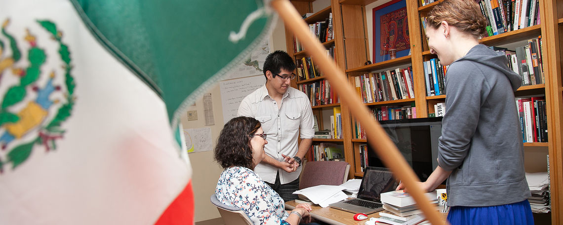 Assitant Professor of History Laura Shelton works with students Cesar Diego, a computer science major, and Morgan Gray, a double major in Spanish and history, in her office in Stager Hall. They are doing summer research related to infanticide in late 19th century Mexico.
