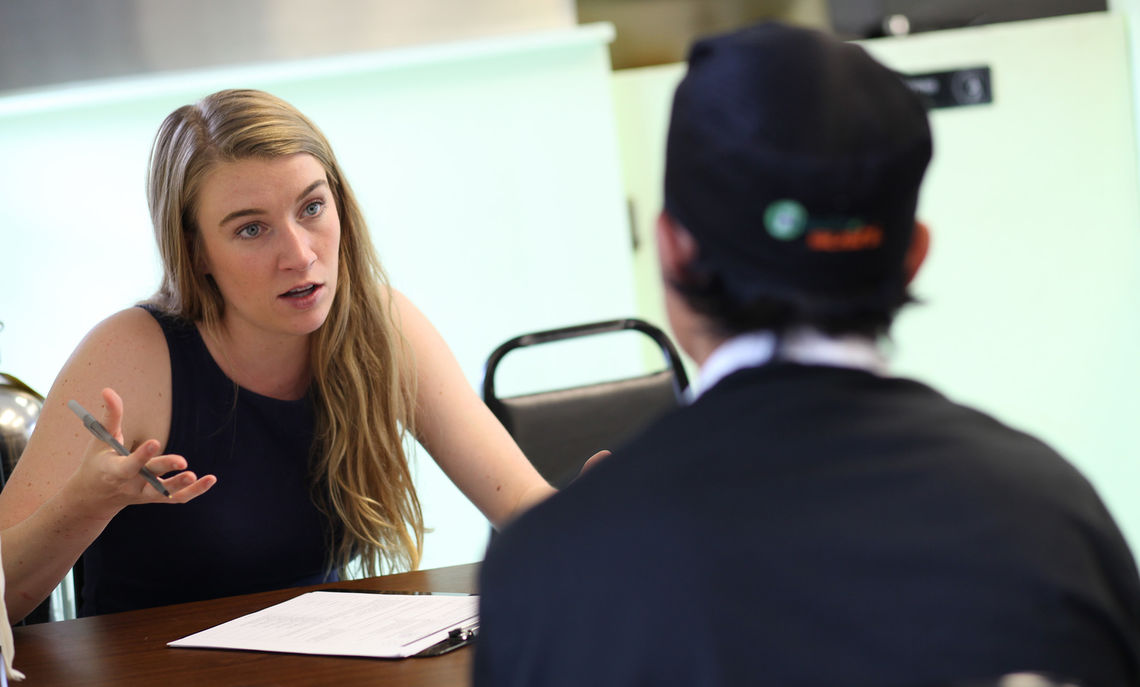 Courtney Rinden '16 discusses a business plan with Kam Li Tangbau, co-owner of Burma Road, a new Lancaster restaurant owned and operated by Burmese refugees. Rinden is participating in Public Service Summer Internship (PSSI) through F&M's Ware Institute for Civic Engagement.