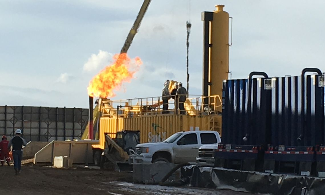 At a fracking site, gas flares during the process.