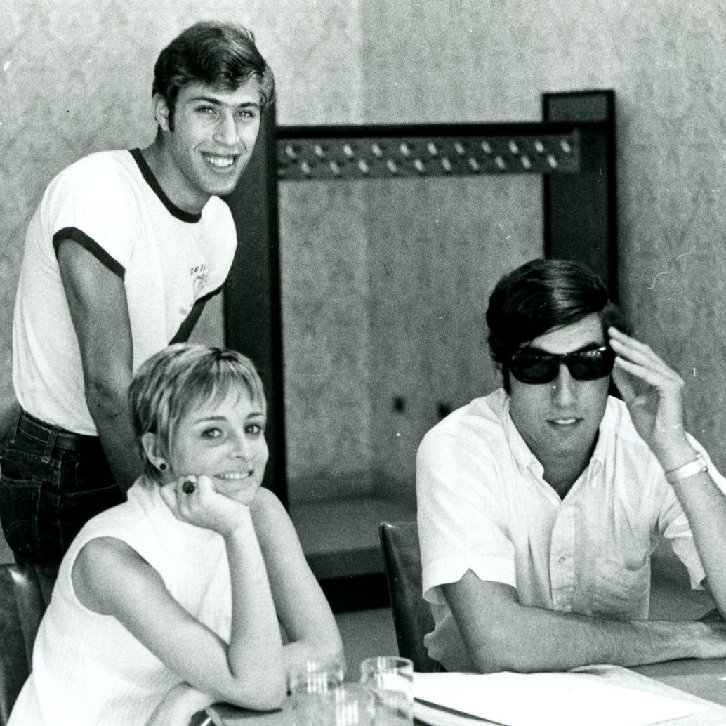 Image of three students at a table. No names are provided.