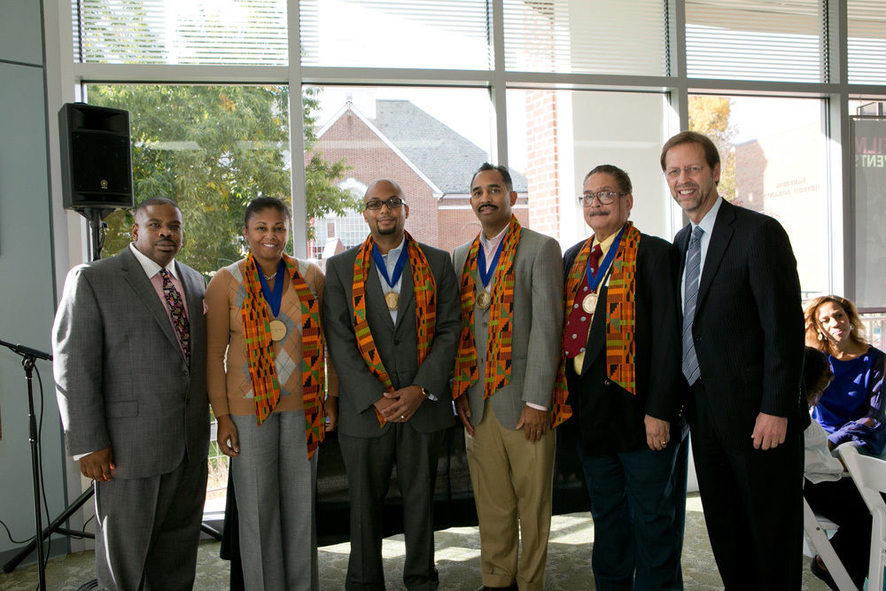 AAAC Chair Tony Ross '91 (far left) and President Porterfield (far right) welcome the first class of Bridgett Award winners at Homecoming 2012. From left, Erika Powell '94, Aaron Bass III '01, H. Phillip Salmon '88 and Antony Mahn '65. Paula Dow, Esq., '77 (not pictured) was also a member of the first class of winners. Photo by Nick Gould.