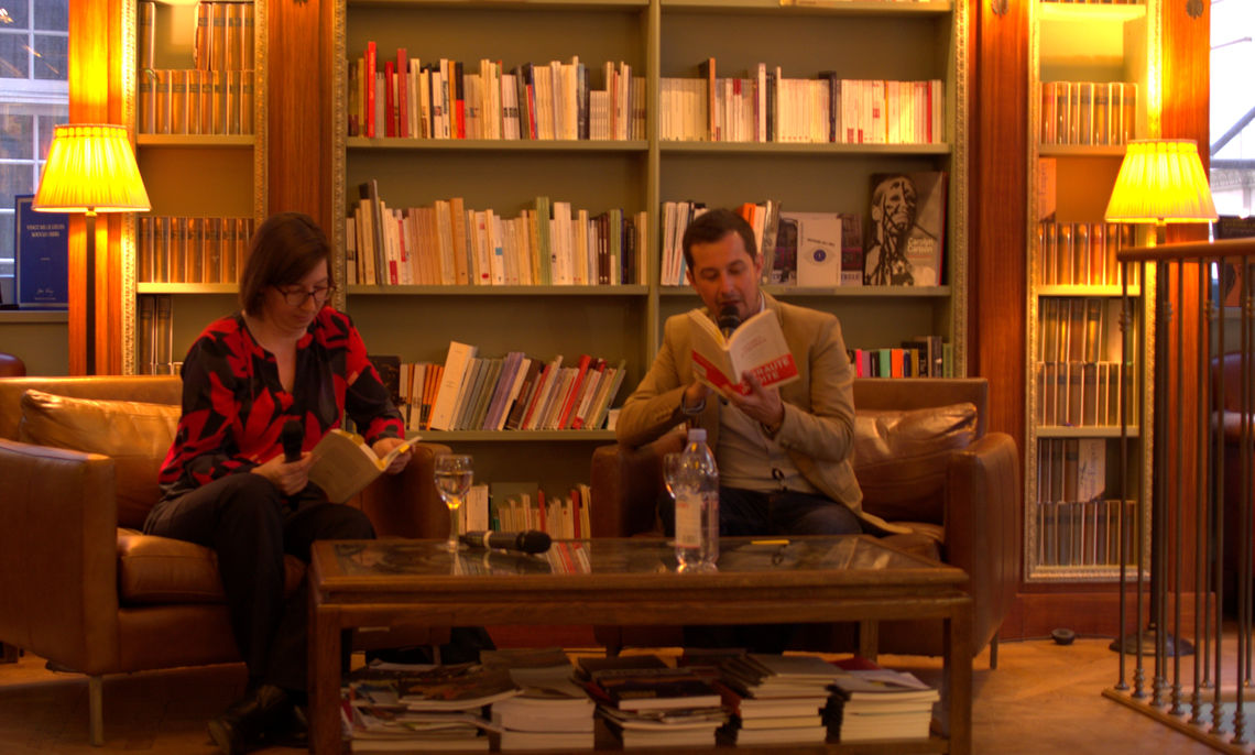 """Carrie Landfried, associate professor of French at Franklin & Marshall College, reads from """"Lettres d'Amérique"""" (""""Letters from America"""") with co-editor Olivier Wagner at the Librairie Albertine in New York."""