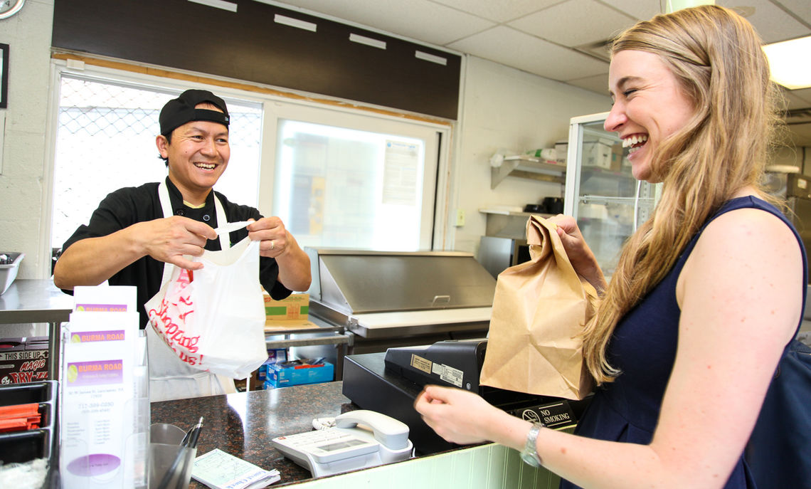 Internships whet more than just intellectual appetites. Courtney orders takeout from a newly opened restaurant in Lancaster City called Burma Road, where she had just completed a survey and an interview with the restaurant owner, Kam Li Tangbau (pictured at left).  Kam participated in one of Assets small business courses.