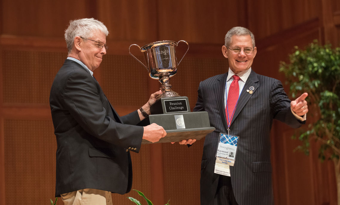 Newly inducted members of the Nevonian Society receive the President's Cup, awarded to the class with the highest alumni participation rate, on behalf of the Class of 1968. They won the award with a rate of 42 percent and 137 gifts, totaling $1,785,365.