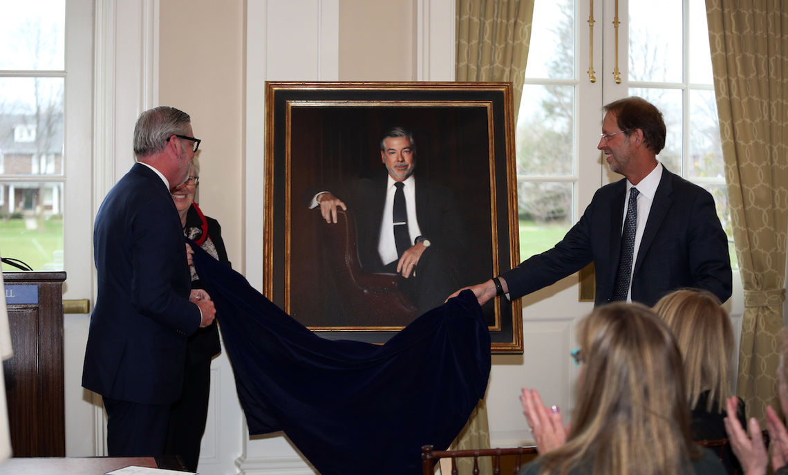 Drexel University President John A. Fry and Franklin & Marshall College President Daniel R. Porterfield unveil Fry's official College portrait April 7. Fry was F&M president from 2002 to 2010. His portrait now hangs in the New College House living room.
