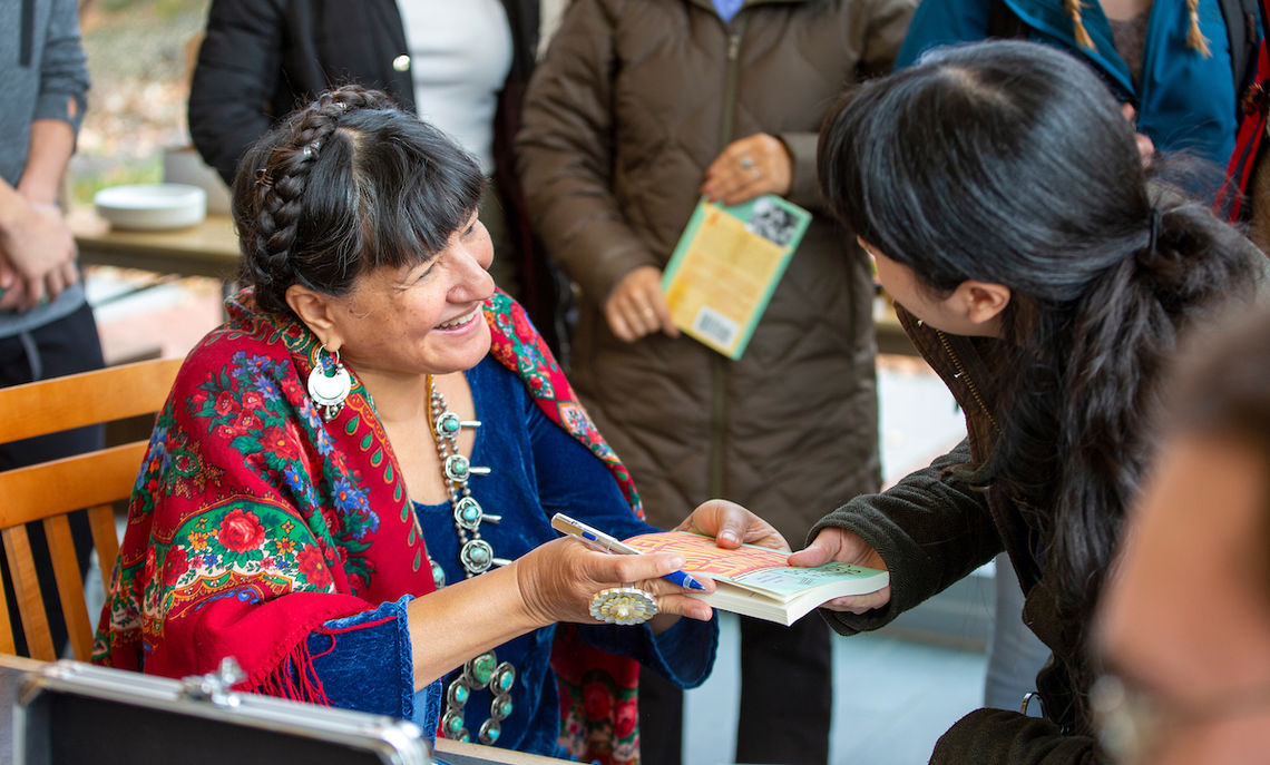 """Sandra Cisneros, author of """" River of Voices: Documenting the Undocumented,"""" met with students during a book-signing reception after the Nov. 14 Common Hour."""