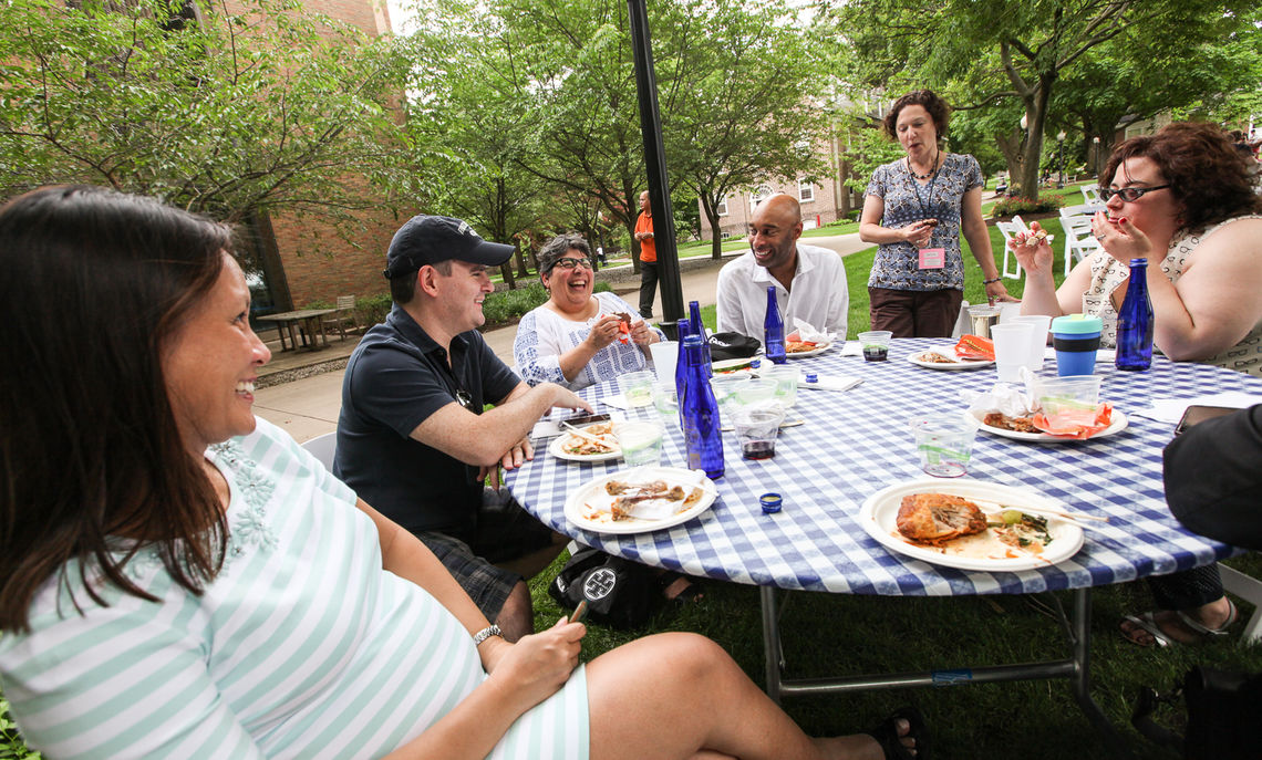 College Chaplain Susan Minasian enjoys a laugh with Senior Associate Dean for Planning and Analysis of Student Outcomes Donnell Butler '95 and other alumni at the Reunion Barbecue.