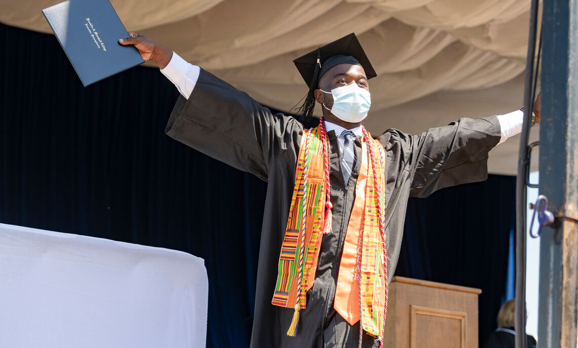 Members of the Class of 2021 receive their diplomas during F&M Commencement held May 15 at Lancaster Clipper Stadium.