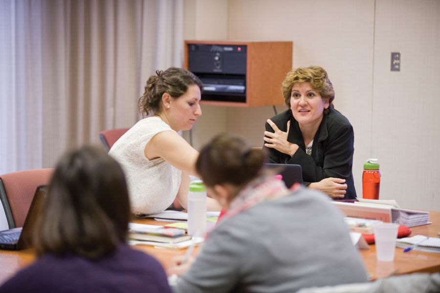 """Susan Dicklitch, professor of government and director of the Ware Institute for Civic Engagement, discusses what it means to be a good citizen with members of her 400-level """"Citizenship"""" course, a community-based learning course that examines the concept and practice of citizenship. (Photo by Eric Forberger)"""