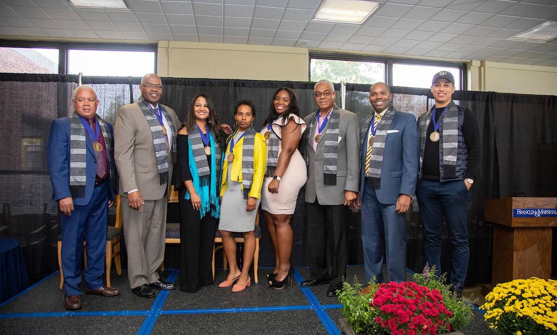 "At the African American Alumni Council's Bridgett Awards Breakfast, President Altmann presented the awards, named for Sydney N. Bridgett '51, to Benjamin Bowser '69, William Vanderberg '76, Yancy Edwards '82, Keenan Smith '94, Christina Watlington '96, Intisar ""Star"" Hamilton '06, Dorina Foster '09 and Shadoe Genesis Tarver '10."