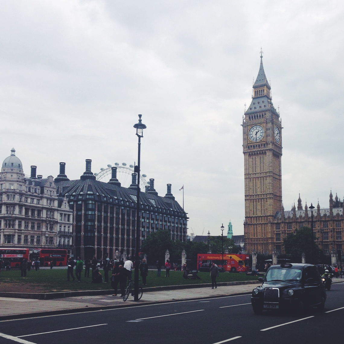 From left, Parliament, Big Ben and Westminster Abbey can be viewed from this street corner, with the top of the London Eye in the background, Europe's tallest Ferris wheel.