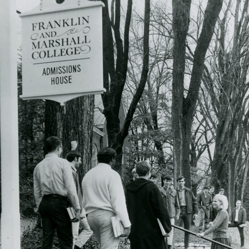 """""""1/8/69 Lancaster, PA: A dozen students greet Susan Vanderzell, the first girl to apply for admission at 171-year-old Franklin and Marshall College, which will go co-ed next fall. About 50 girls are expected to enroll in September, and ultimately the ratio of the 1600-member student body will be about 12 to 1, just as it was in the group when Susan made campus history recently with her application for admission. UPI Telephoto"""""""