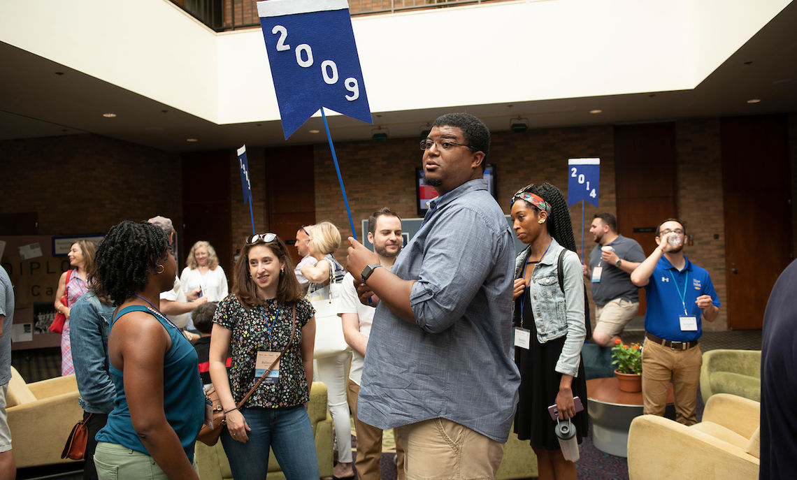 Alumni gather for the Reunion Class Parade inside the Steinman College Center.