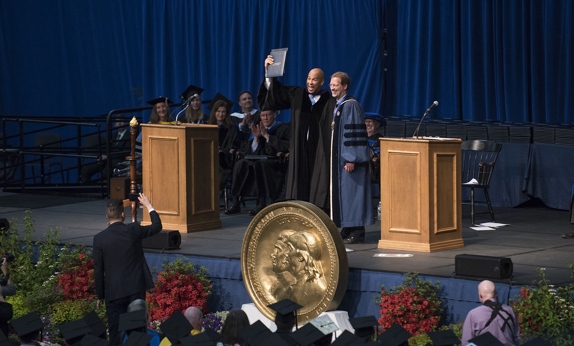 U.S. Sen. Cory A. Booker holds aloft his honorary degree after being introduced by F&M President Daniel R. Porterfield.