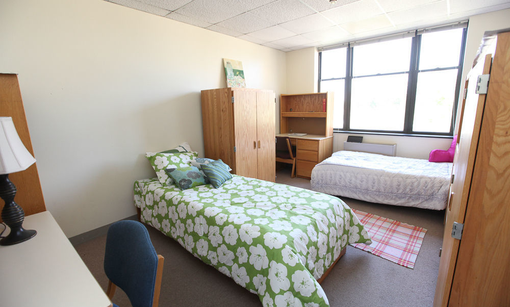 F&M students lead a campus tour for visitors. Pictured is a dorm room in Weis College House