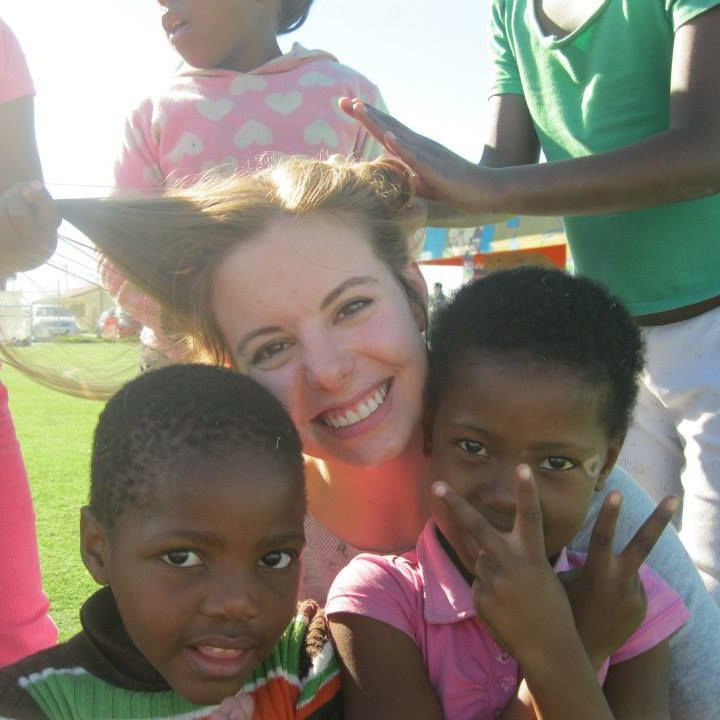 Dani Roth '14 enjoys a playful moment with children in a South African township.