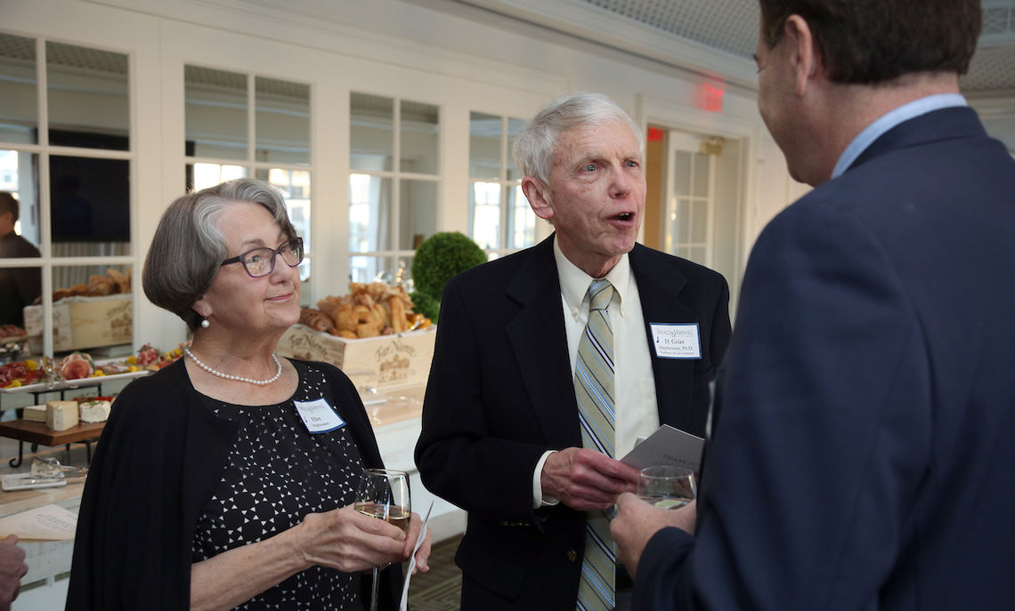 Professor Grier Stephenson and his wife, Ellen, greet one of the many alumni who came to honor their former professors.