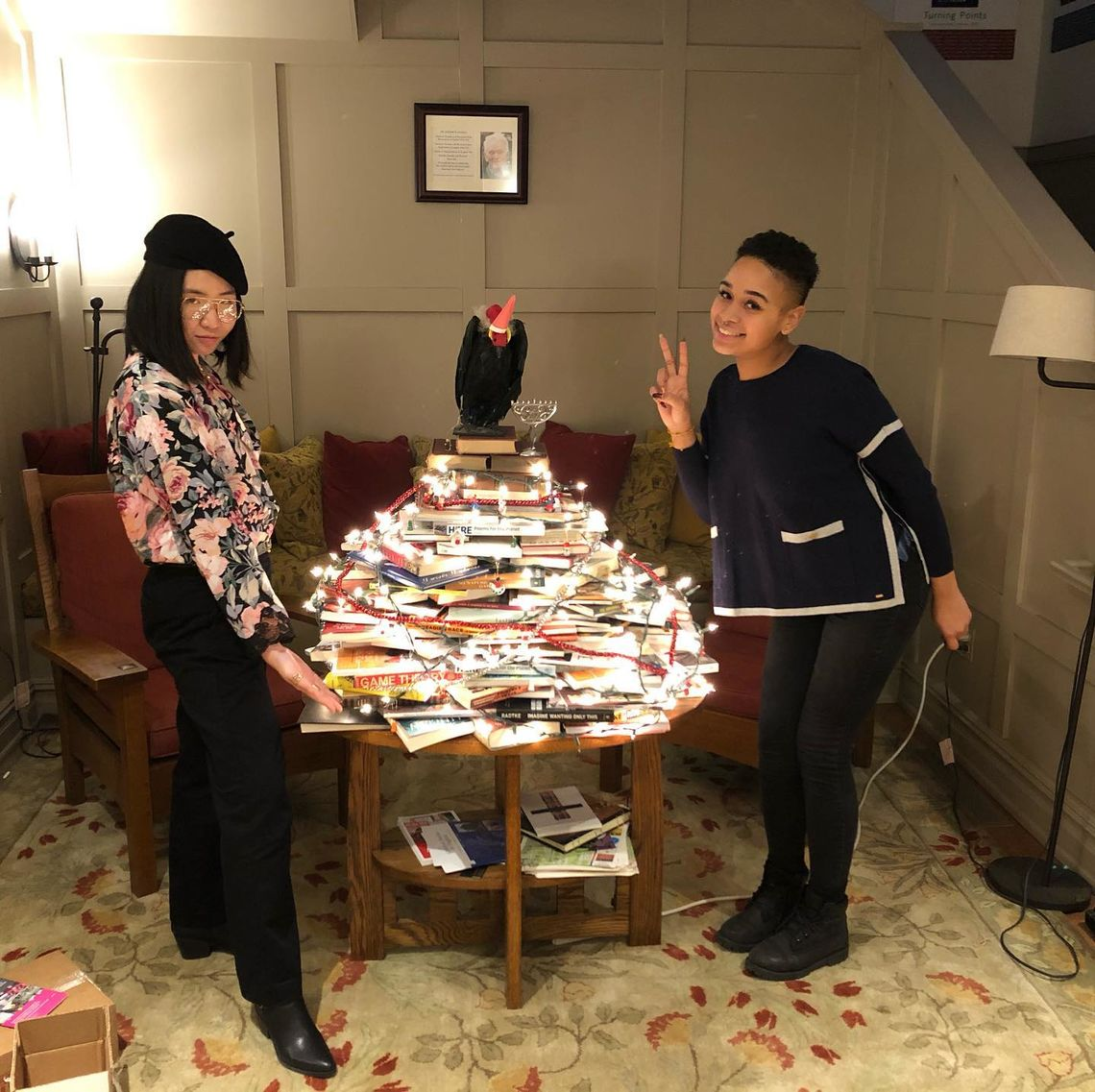 An Ly and Coral Bello build a Bookmas tree! 12/2/19