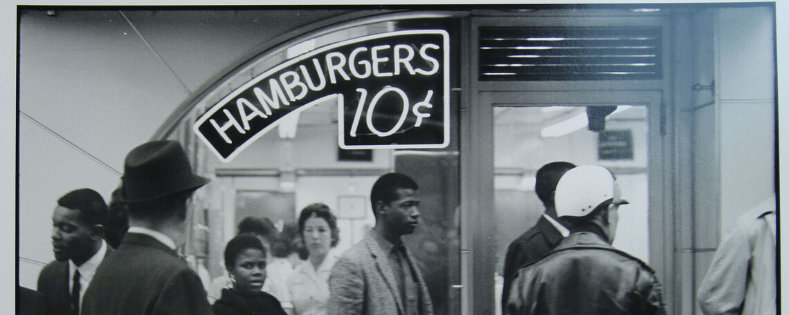 """Danny Lyon (American, b. 1942). Outside, Lester MacKinney, Bernice Reagon, and John O'Neal wait to get in [a Nashville Tic Toc restaurant], 1962. Gelatin silver print, printed later, 11 x 14"""". Gift of Dr. and Mrs. Stephen Nicholas."""