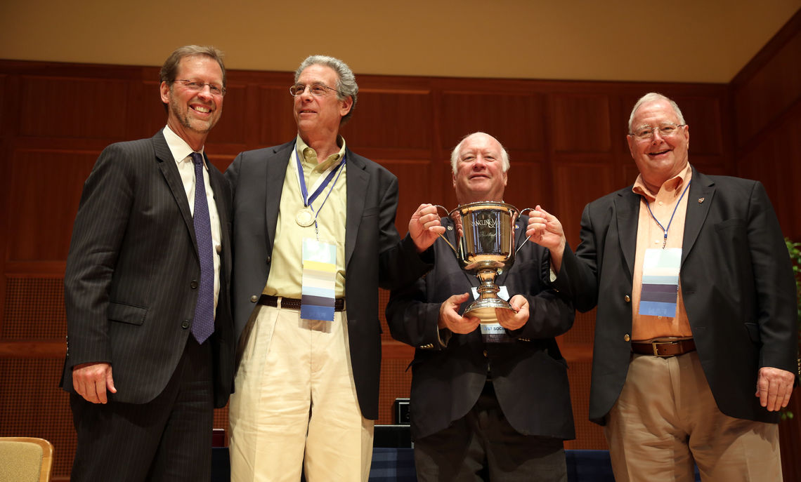President Porterfield presented the President's Cup to the leaders of the Class of 1966: Tony Kreisel '66, Bob Brooks '66, P'98 and Reeve Askew '66, P'96.