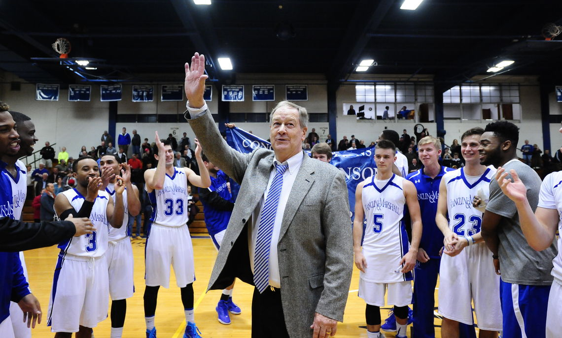 Coach Robinson acknowledges the crowd in Mayser Gym following the Diplomats' victory over Swarthmore in January, the 900th of his storied career.