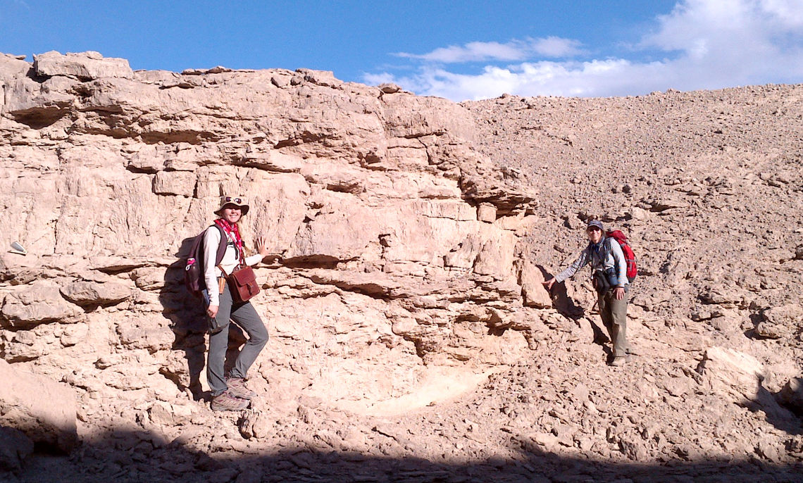 In the Chilean desert, Driscoll looks for the best place to obtain a rock sample that she will return with to F&M for analysis in the Department of Earth and Environment while Professor Carol de Wet searches for more good samples.