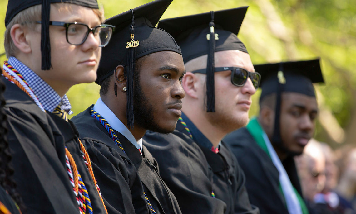 Graduates considering the future as they listen to encouragement from the day's speakers.