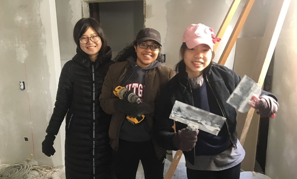 Students pose with tools while mudding a house in Roanoke, VA on the 2018 ASB trip