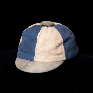 """Many alumni still have these caps, referred to as """"dinks,"""" in their closets and boxes at home. The dinks were given to freshmen in the early and mid-20th century to wear during their first year on campus. More than a dozen ended up in the College's archives, while some are still in action-numerous alumni wear them each year to class reunions at Alumni Weekend. This wool dink belonged to a member of the Class of 1934."""